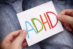young-boy-holds-adhd-text-written-sheet-paper-attention-deficit-hyperactivity-disorder-close-up-65137383